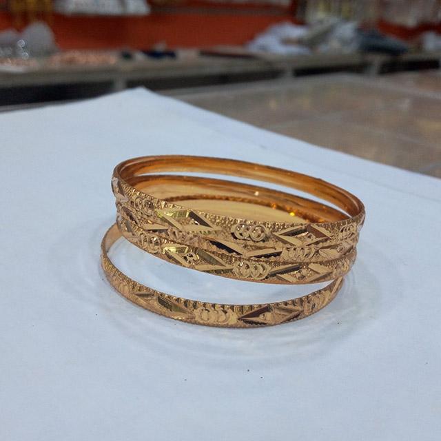 Gold patterned Bangle Bracelets 4 piece set